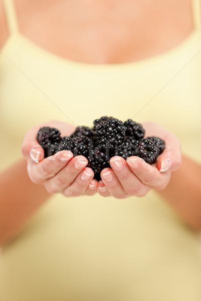 Woman holding fresh blackberries in hands closeup Stock photo © Maridav