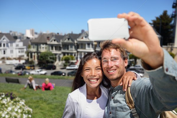 Happy young couple in San Francisco Alamo Square Stock photo © Maridav