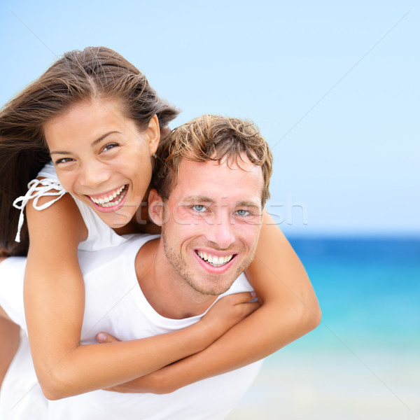 Happy couple on beach summer fun vacation Stock photo © Maridav