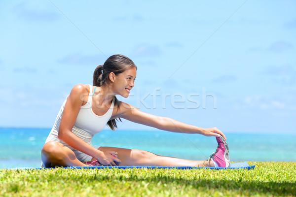 Woman stretching legs exercise training fitness Stock photo © Maridav