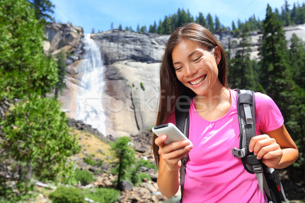 Smartphone - woman hiker using smart phone on hike Stock photo © Maridav
