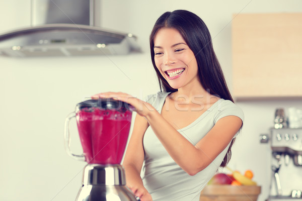 Smoothie woman making fruit smoothies Stock photo © Maridav