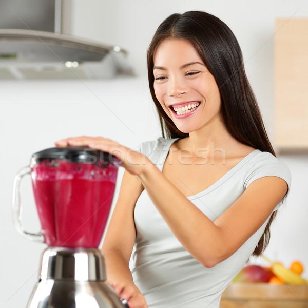 Smoothie woman blending healthy beet - fruit juice Stock photo © Maridav
