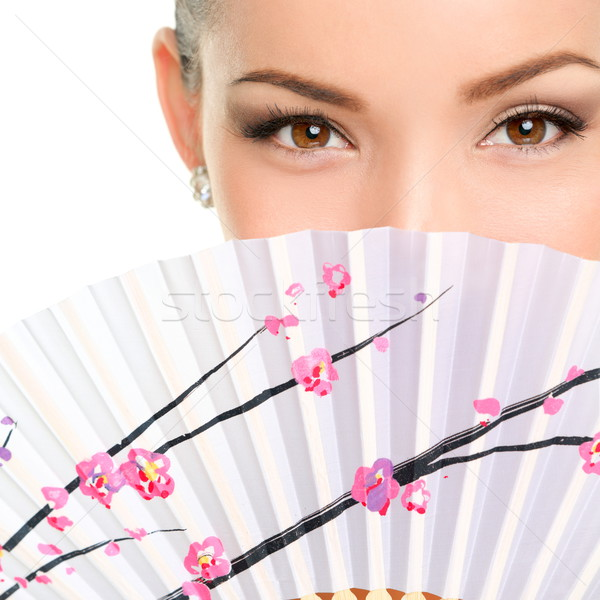 Closeup Portrait Of Young Woman With Folding Fan Stock photo © Maridav