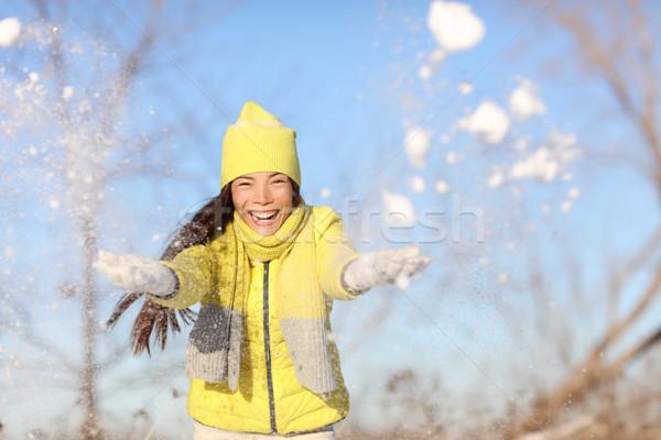 Winter fun woman playing in snow outside Stock photo © Maridav