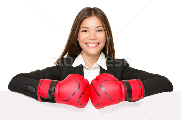 Femme d'affaires signe gants de boxe femme d'affaires boxeur costume Photo stock © Maridav