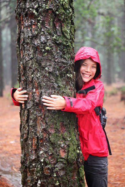 Happy female tree hugger Stock photo © Maridav