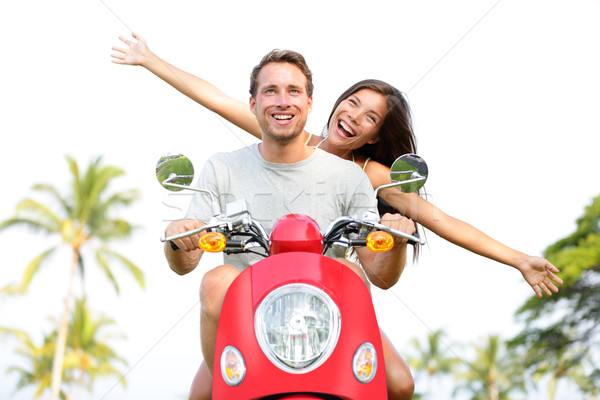 Happy free freedom couple driving scooter Stock photo © Maridav