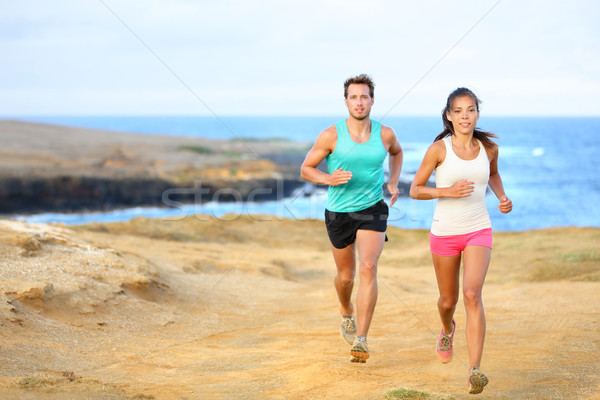 Sports couple jogging for fitness running outside Stock photo © Maridav