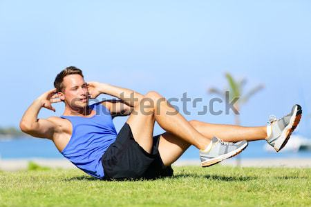 Push-ups - fitness man training push up outside Stock photo © Maridav