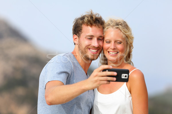 Selfie with smartphone - couple self-portrait Stock photo © Maridav