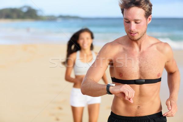 работает человека бег частота сердечных сокращений контроля молодым человеком Сток-фото © Maridav
