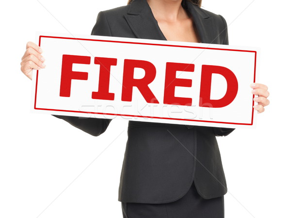 Unemployment - woman holding Fired sign on white Stock photo © Maridav