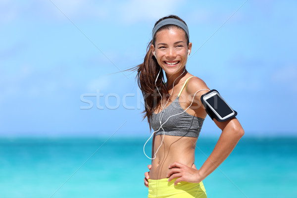 Happy fitness woman living a fit healthy lifestyle Stock photo © Maridav