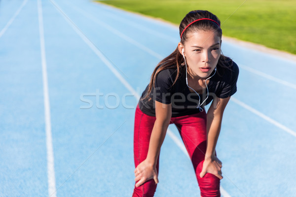 Stock photo: Runner resting tired on running track ready to run