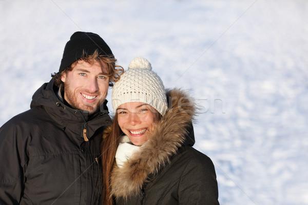 Happy winter interracial couple outdoors portrait Stock photo © Maridav