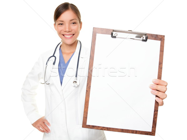 Medical sign - doctor showing clipboard Stock photo © Maridav