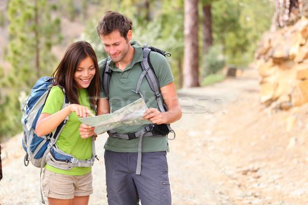 Hiking - hikers looking at map Stock photo © Maridav
