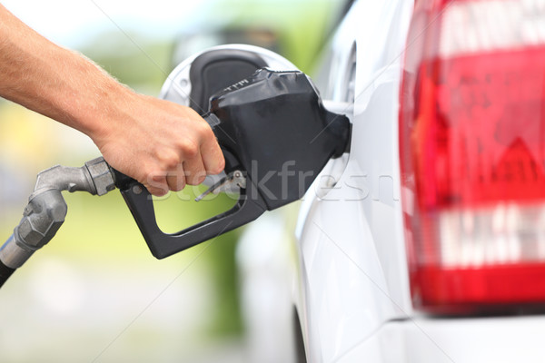 Pumping gas at gas pump Foto stock © Maridav