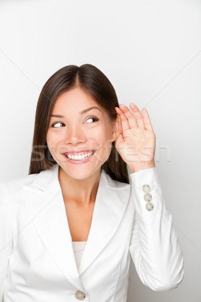 Business woman listening with hand to ear concept Stock photo © Maridav