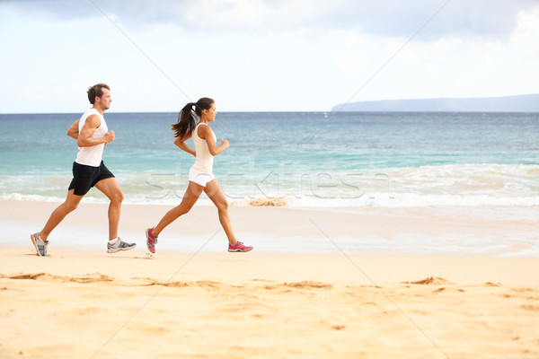 Stock photo: Running people - woman and man athlete runners