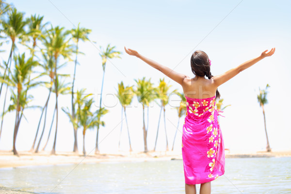Praising happy freedom woman on beach in sarong Stock photo © Maridav
