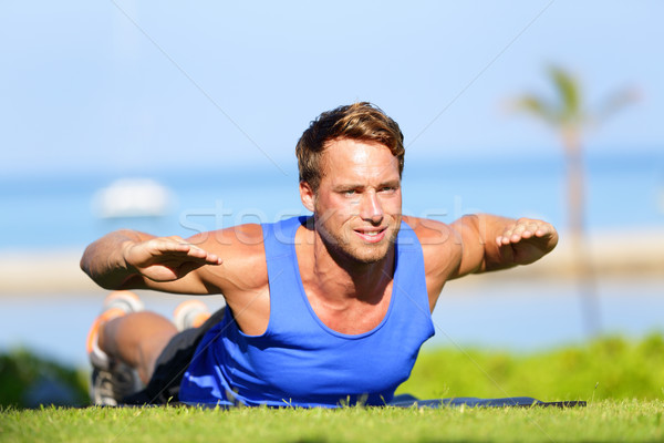 Fitness man training back extension exercise Stock photo © Maridav