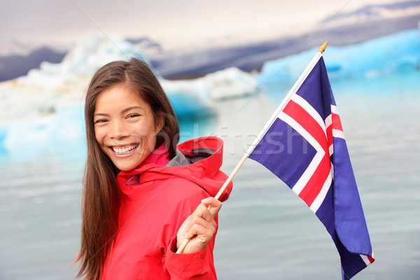 Icelandic flag - girl holding Iceland flag at glacier Stock photo © Maridav