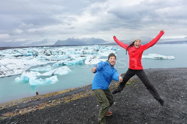 Travel people couple having fun jumping on Iceland Stock photo © Maridav