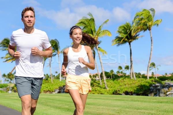 People running in city park - active lifestyle Stock photo © Maridav