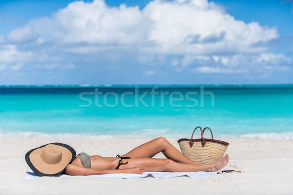 Beach sexy woman tanning with hat protecting face Stock photo © Maridav