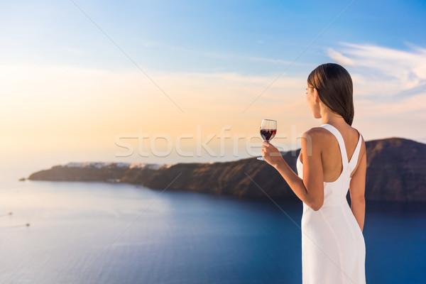 Vrouw drinken rode wijn luxe terras jonge vrouw Stockfoto © Maridav