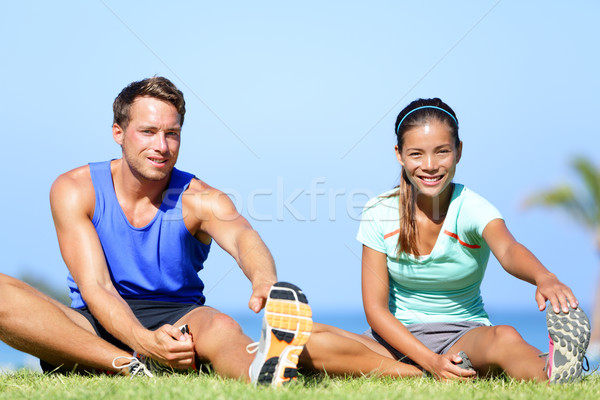 Stretching exercises - Fitness couple outside Stock photo © Maridav