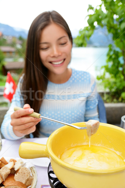 Cheese fondue - woman eating Swiss food Stock photo © Maridav