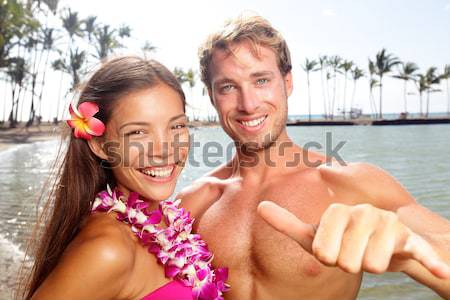 Sun tanned good looking couple at beach Stock photo © Maridav