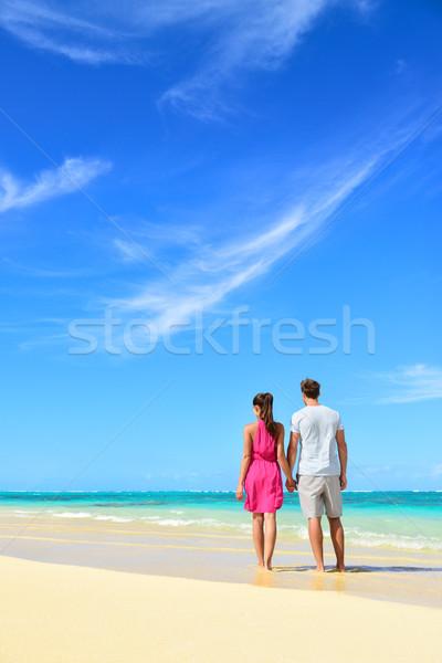 Beach vacation couple relaxing on summer holidays Stock photo © Maridav