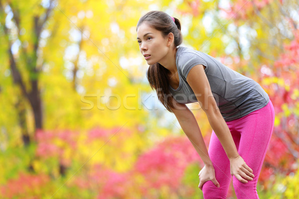 Athlete runner resting after running - Asian woman Stock photo © Maridav