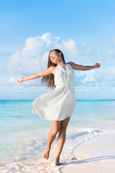 Freedom beach woman feeling free dancing in dress Stock photo © Maridav