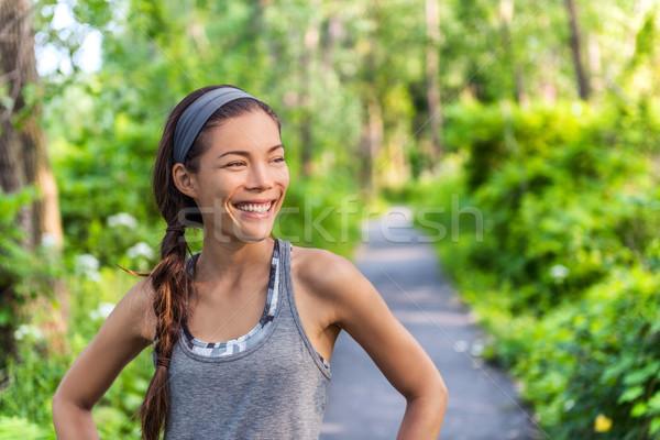 Happy fitness Asian runner girl in forest park Stock photo © Maridav