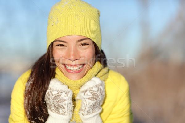 Happy winter girl laughing having fun in snow Stock photo © Maridav