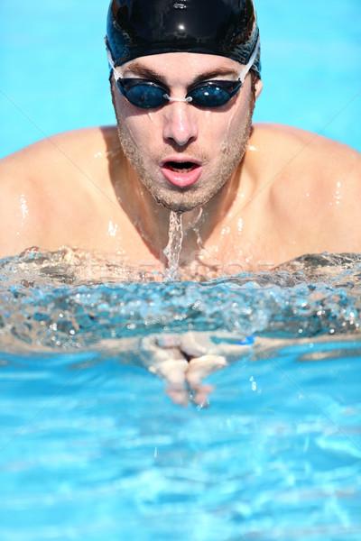 Swimmer - man swimming breaststroke Stock photo © Maridav