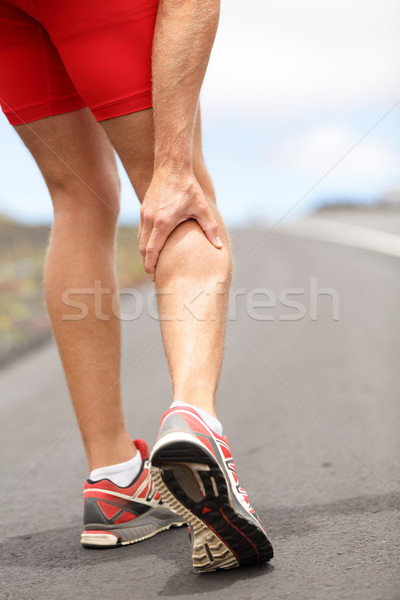 Stock photo: Cramps in leg calves