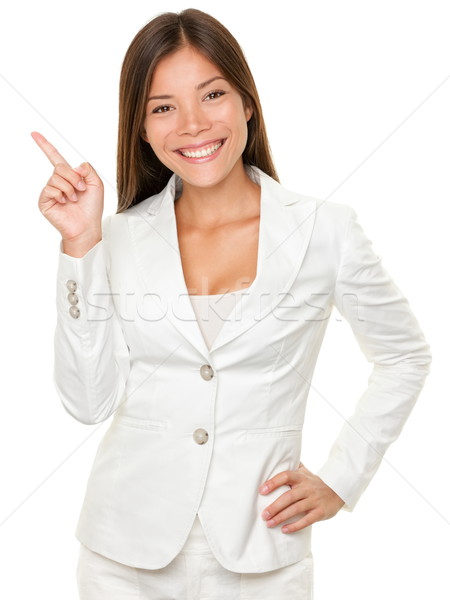 Businesswoman With Hand On Hip Pointing Sideways Stock photo © Maridav