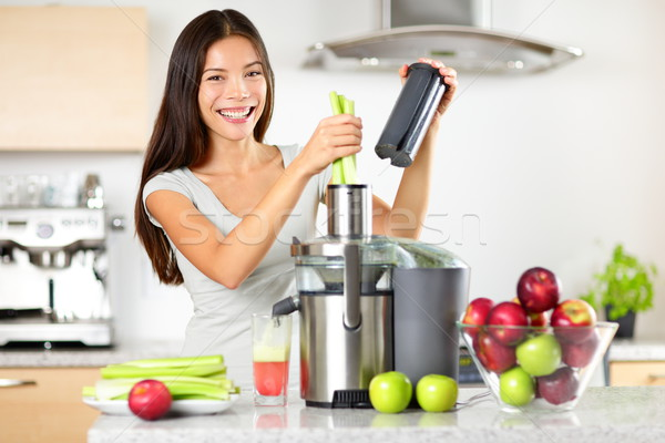 Vegetable juice raw food - healthy juicer woman Stock photo © Maridav