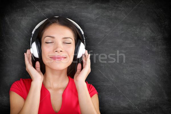 Música fones de ouvido bela mulher escuta belo jovem Foto stock © Maridav