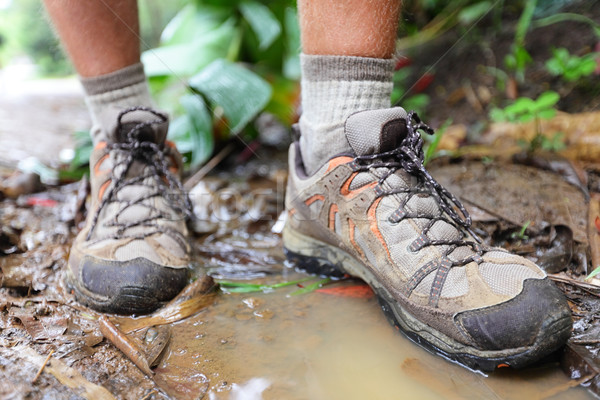 Stock photo: Hiking shoes on hiker in water puddle