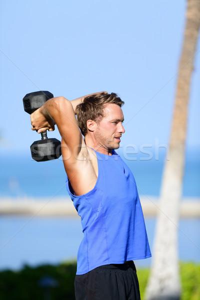 Fitness człowiek hantle szkolenia triceps Zdjęcia stock © Maridav
