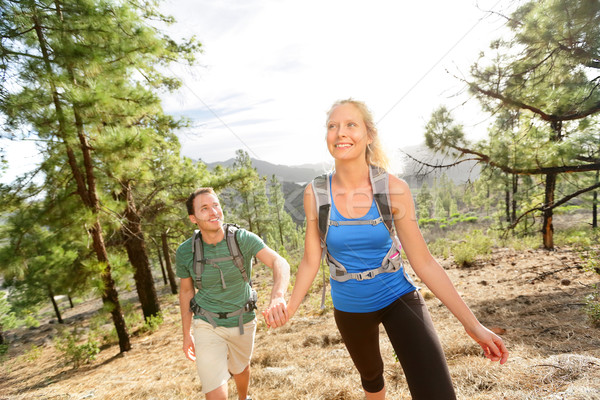 People on hike - couple hiking in forest Stock photo © Maridav