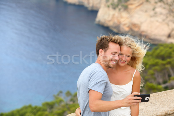 Dating travel couple taking selfie photo picture Stock photo © Maridav