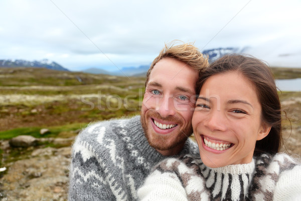 Iceland couple selfie wearing Icelandic sweaters Stock photo © Maridav